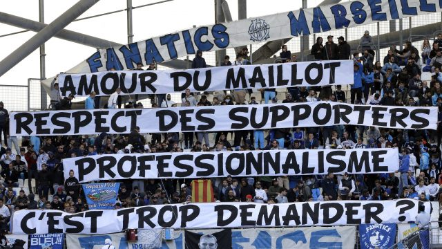 "Marseille supporters display banners reading ""Love of the jersey, respect for supporters, professionalism, is it too much to ask?"""