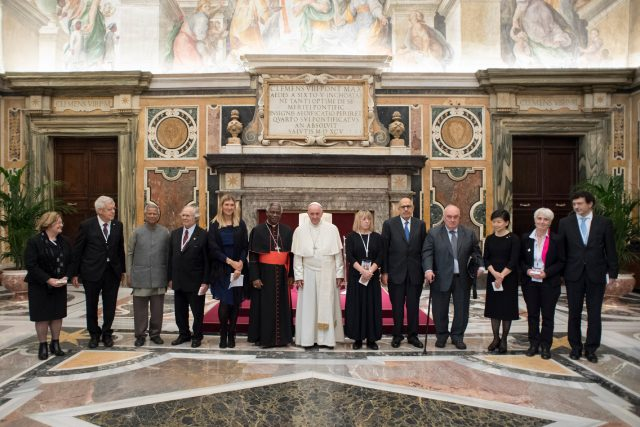 Francis poses with participants in the International symposium on a nuclear weapons free world