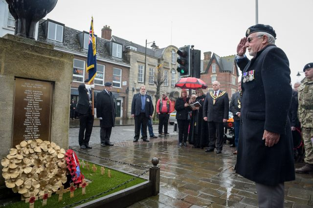 A member of the Royal British Legion salutes after laying a wreath at the war memorial at Royal Wootton Bassett