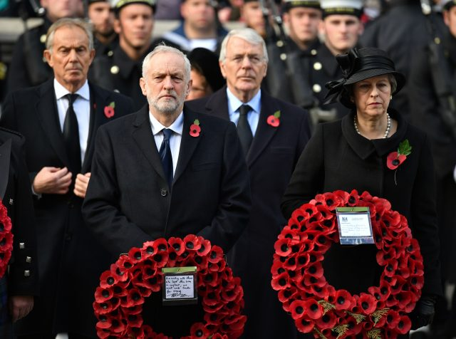 Labour leader Jeremy Corbyn stands next to Prime Minister Theresa May, with former prime ministers Tony Blair (left) and Sir John Major behind them