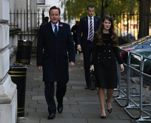 Former prime minister David Cameron walks through Downing on his way to the service Street