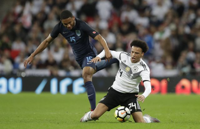 England's Joe Gomez challenges Germany's Leroy Sane for the ball in Friday night's friendly