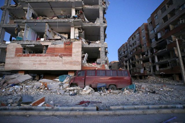 Destroyed buildings and a car are seen after an earthquake at the city of Sarpol-e-Zahab in western Iran