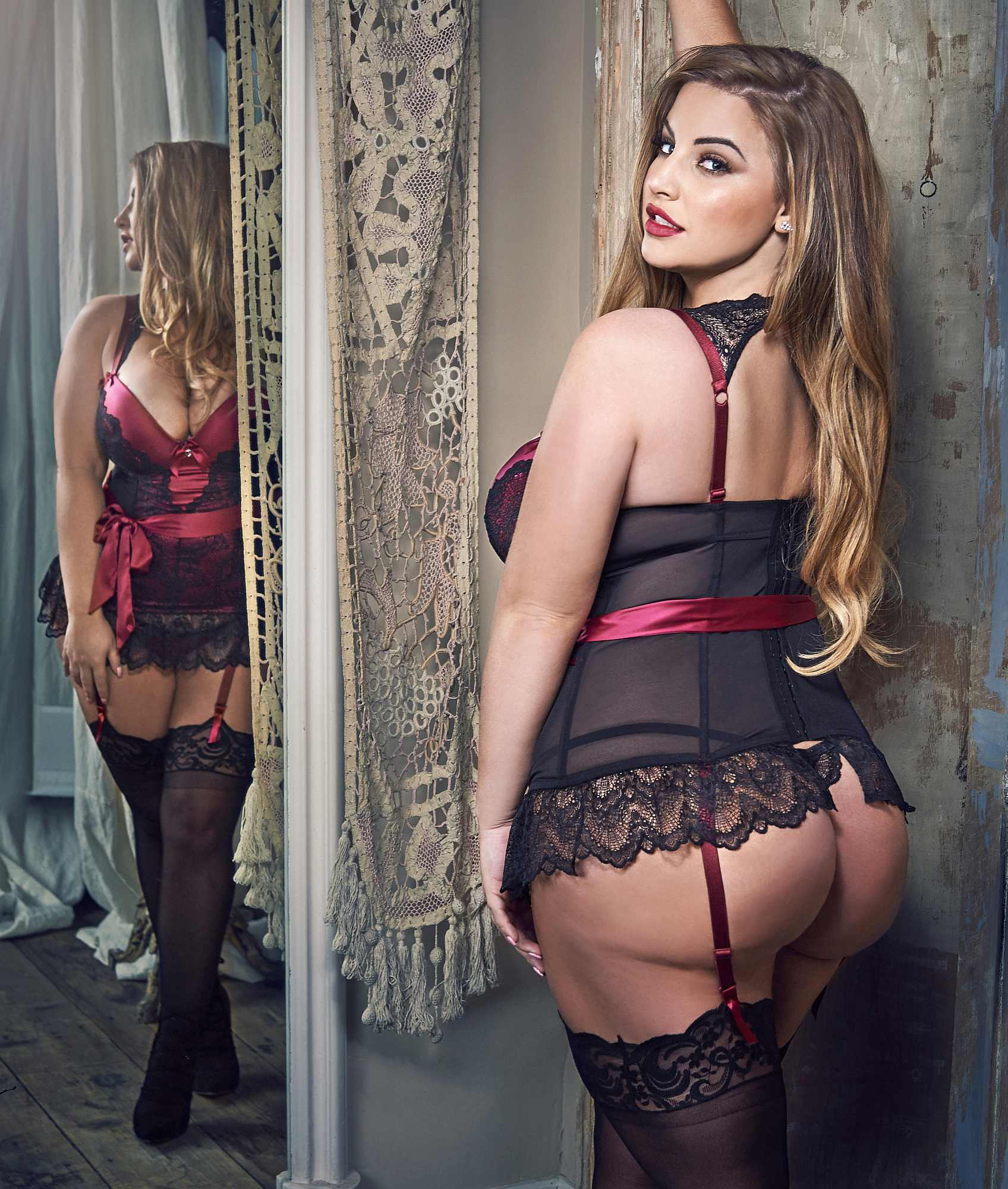 Ashley Alexiss wears Lovehoney Moonlight Black Satin & Lace Plunge Basque Set