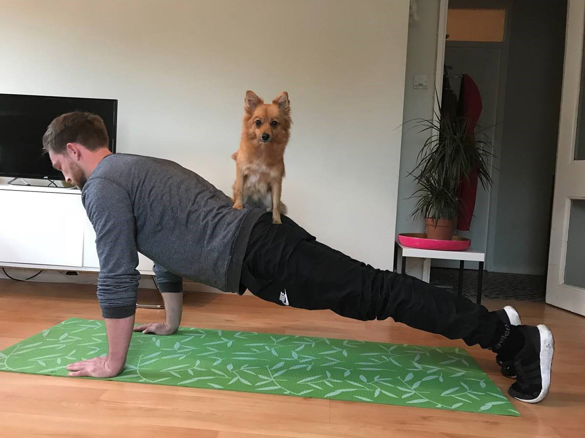 Man practising doga (Right Path Fitness/PA)