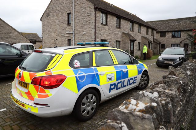 Police outside a property in Manor Gardens in Swanage (Andrew Matthews/PA)