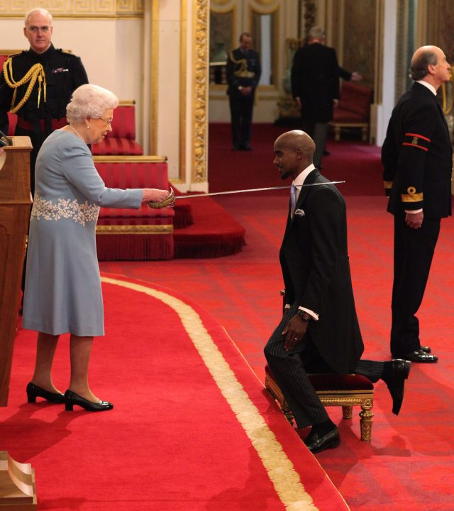 The Queen knights Sir Mohammed Farah at Buckingham Palace (Jonathan Brady/PA)