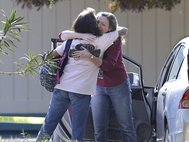Women embrace outside Rancho Tehama Elementary School