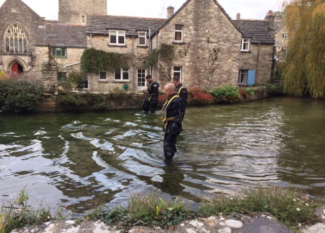 Police teams search a mill pond in Swanage, Dorset (Jennifer Cockerell/PA)