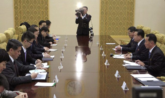 Choe Ryong Hae, second from right, vice chairman of the Central Committee of North Korea's ruling party talks with Song Tao, fourth from left, the head of China's ruling Communist Party's International Liaison Department, at the Mansudae Assembly Hall, in Pyongyang