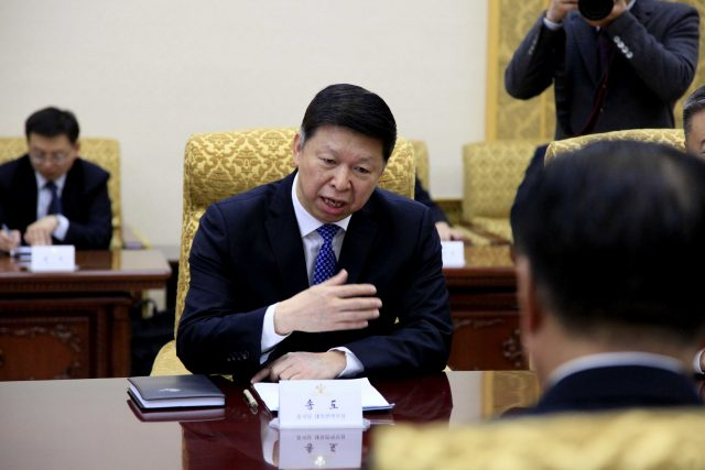 Song Tao, the head of China's ruling Communist Party's International Liaison Department, speaks with Choe Ryong Hae