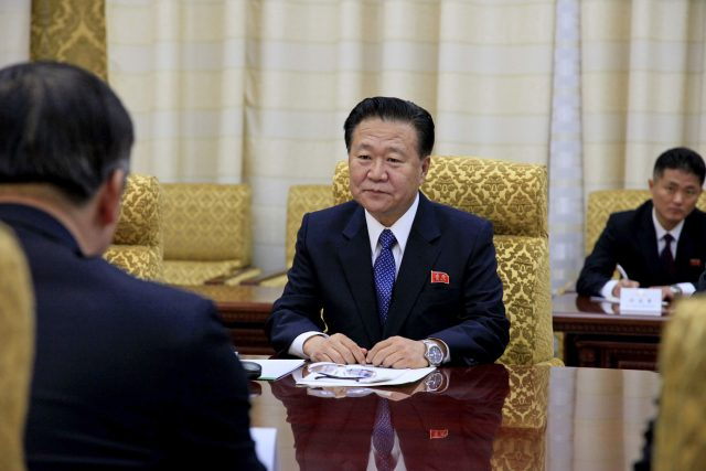 Choe Ryong Hae, centre, vice-chairman of the Central Committee of North Korea's ruling party, speaks with visiting Song Tao