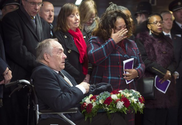 Relatives and friends gather at a memorial service for the 30th anniversary of the King's Cross fire, at King's Cross station in London