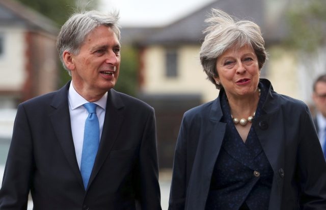 PM Theresa May and Chancellor Philip Hammond. (Hannah McKay/PA)