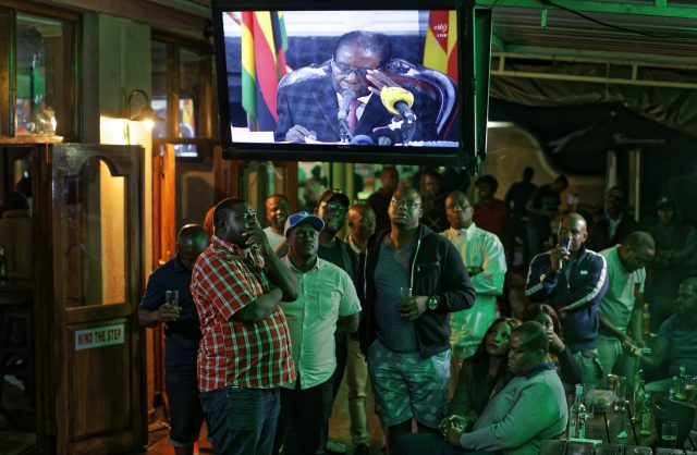 Disappointed Zimbabweans watch the televised address. (Ben Curtis/AP)
