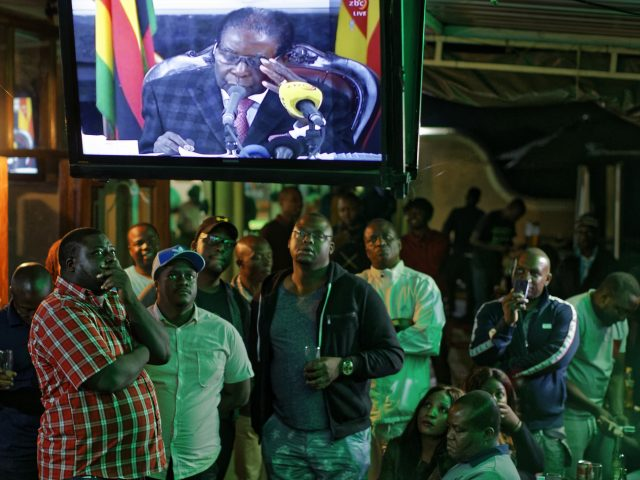 Zimbabweans watch the address in Harare