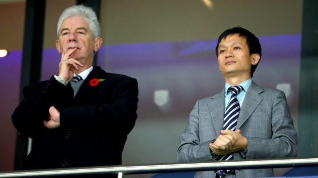 West Brom owner Guochuan Lai (right) with chairman John Williams at Saturday's 4-0 defeat to Chelsea