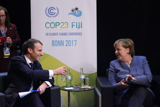 German Chancellor Angela Merkel right talks to French president Emmanuel Macron during the 23rd Conference of the Parties climate talks in Bonn Germany