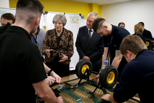 Theresa May visits an engineering training facility in the West Midlands