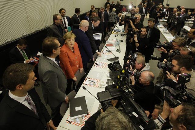 German Chancellor Angela Merkel, centre in talks with fellow German political leaders