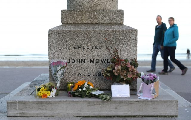 Floral tributes for Gaia Pope are left at the King Alfred Monument on the seafront in Swanage