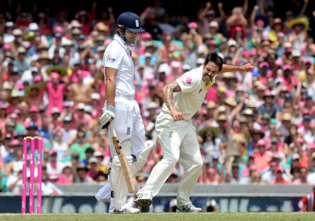 Mitchell Johnson, right, celebrates after taking Alastair Cook's wicket