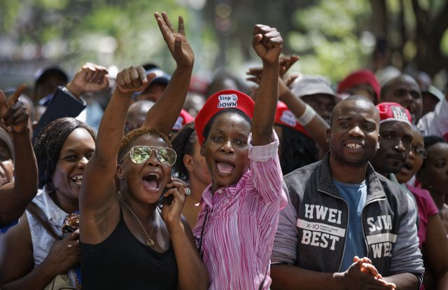 Protesters outside Zimbabwe's parliament cheer the news of Robert Mugabe's resignation