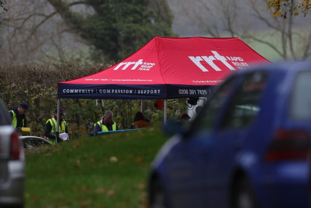 A rapid relief tent is put up at the entrance to the crash site