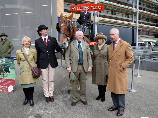 Charles and Camilla pose for a photograph with guests at Ascot (PA)