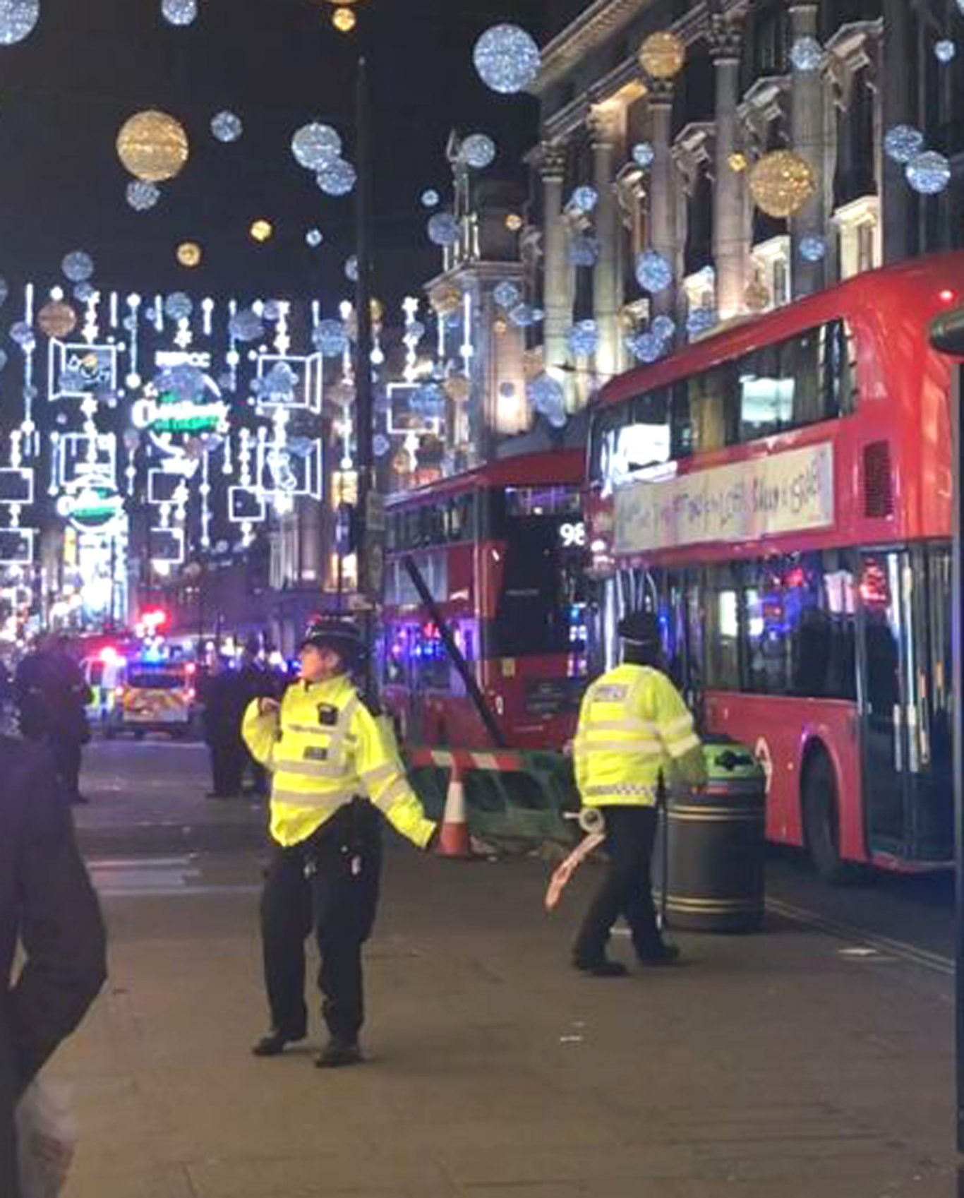 The scene in Oxford Street as police responded (Georgina Stubbs/PA)