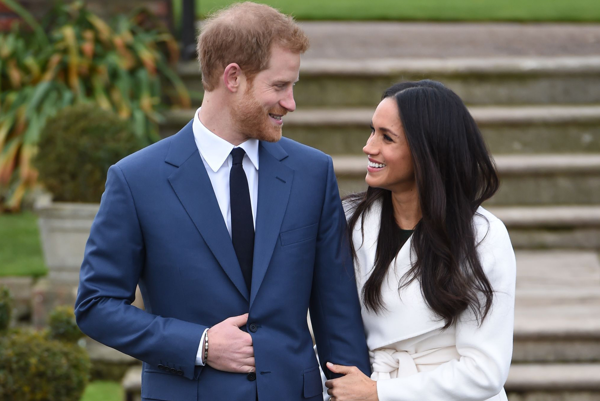 Prince Harry and Meghan Markle in the Sunken Garden at Kensington Palace, London, after the announcement of their engagement.