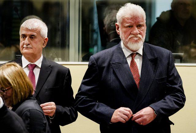 Bruno Stojic and Slobodan Praljak, right, enter the Yugoslav War Crimes Tribunal in The Hague