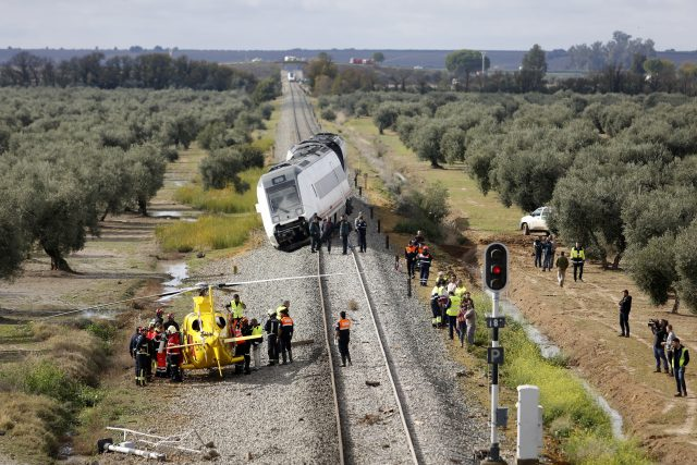 A train carriage is seen derailed near the town of Arahal in Spain