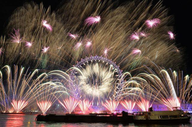 Fireworks light up the sky over the London Eye