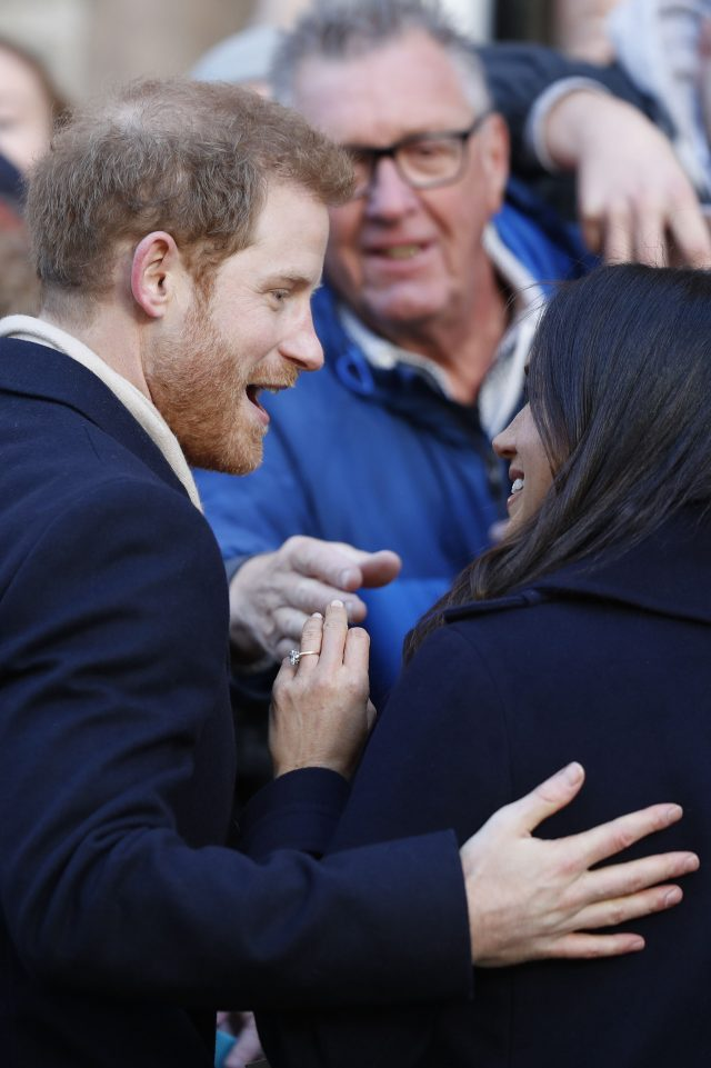 The engagement ring was on show as Prince Harry and Meghan Markle met well-wishers (Adrian Dennis/PA)