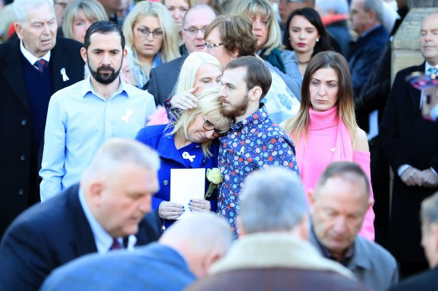 Mr Sargeant's wife, Bernie was comforted by their son Jack  (Peter Byrne/PA)