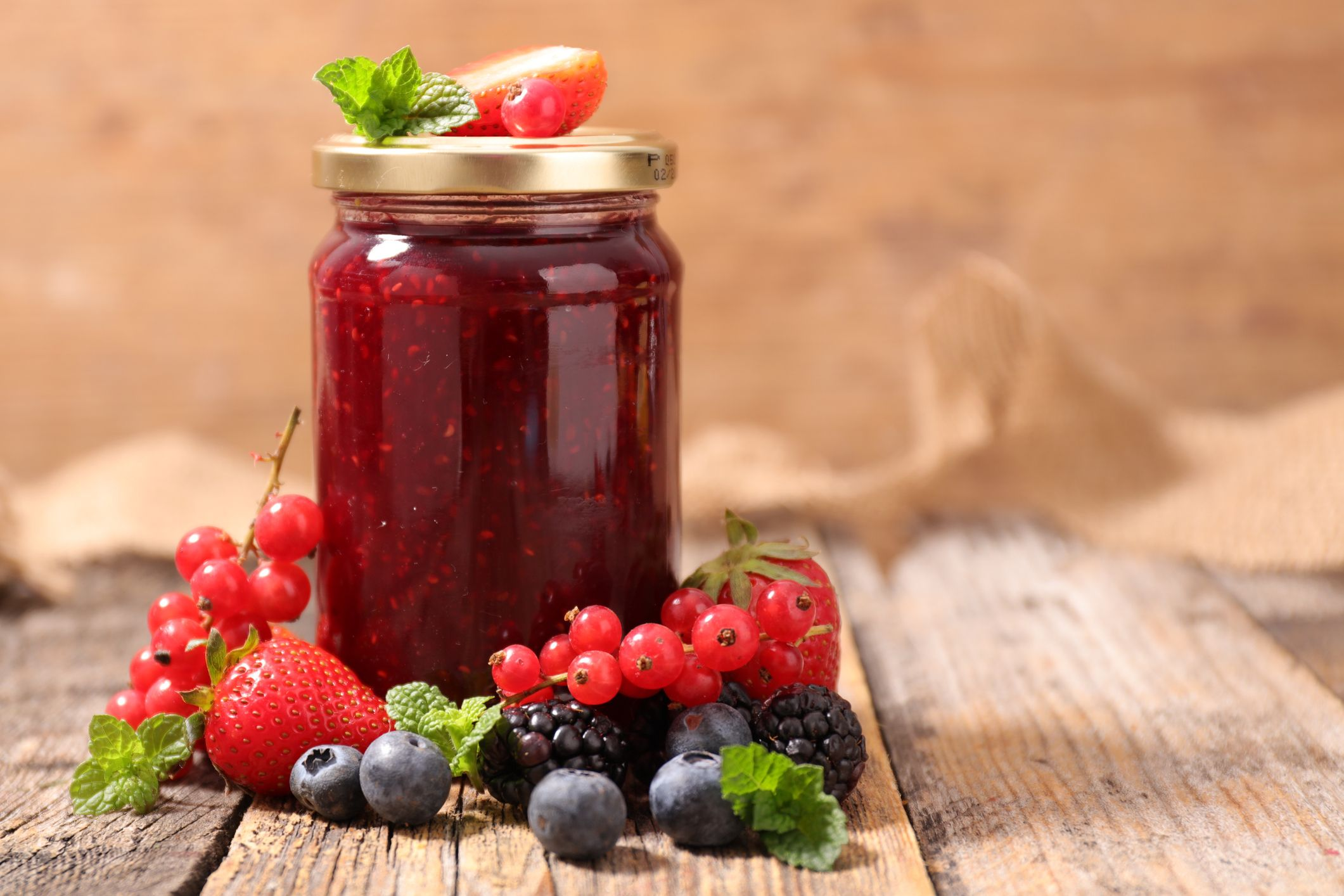 Jam jar with berry fruits
