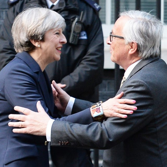Theresa May with European Commission president Jean-Claude Juncker