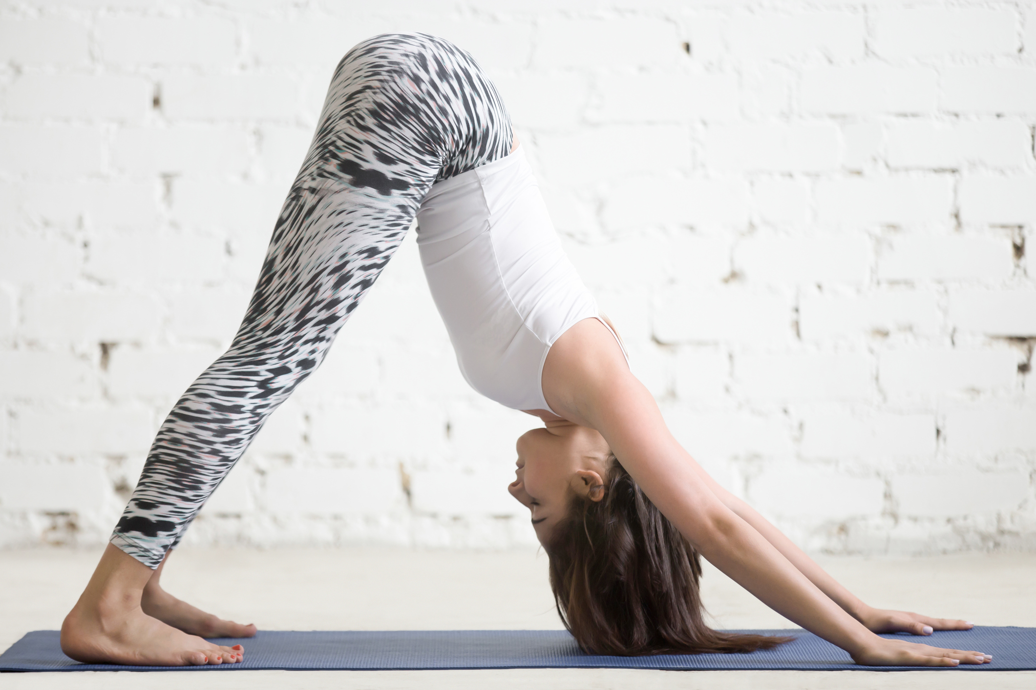 Young woman in Downward facing dog yoga position (Thinkstock/PA)