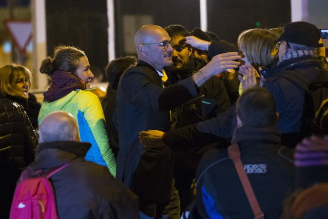 Fired Catalan Cabinet member Raul Romeva, centre, is greeted by supporters and friends as he leaves the Estremera jail, south-east of Madrid, Spain