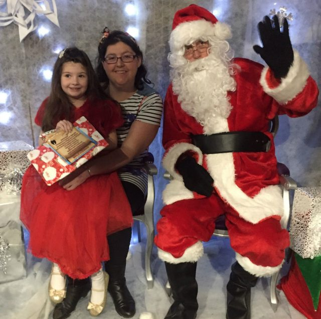 Phoebe Hope Vines with her mother Becky Vines visiting Santa in 2016