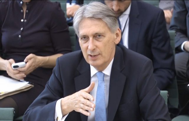 Chancellor Philip Hammond answering questions at the Commons Treasury Select Committee (PA)