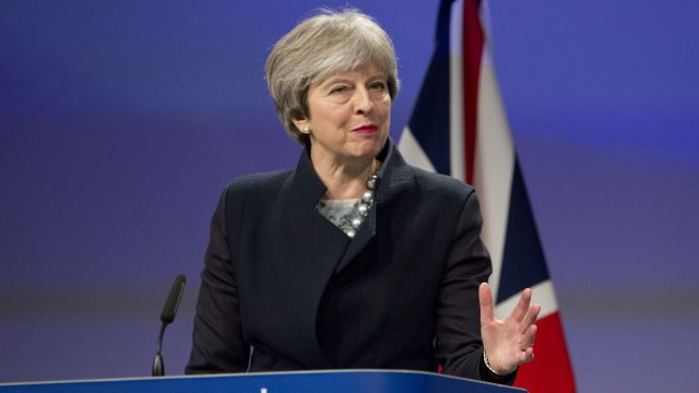 Theresa May is under pressure to move on to the next stage of Brexit talks before the end of the year (Virginia Mayo/AP)