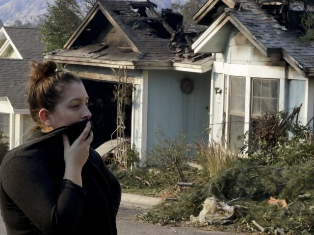 Crystal Shore examines damage in the Sylmar area of Los Angeles (Chris Carlson/AP)