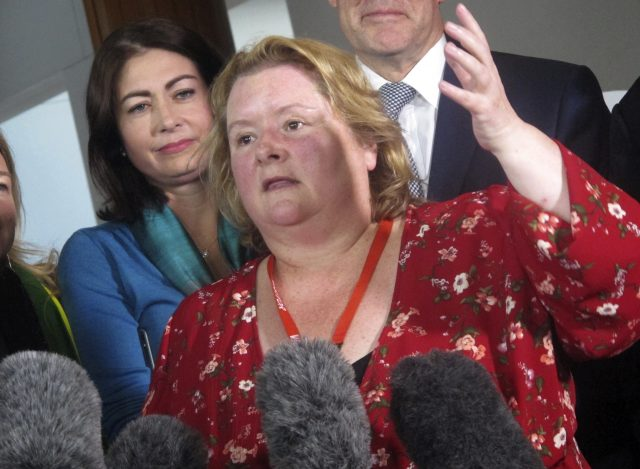 Australian actress Magda Szubanski celebrates at Parliament House (AP Photo/Rod McGuirk)