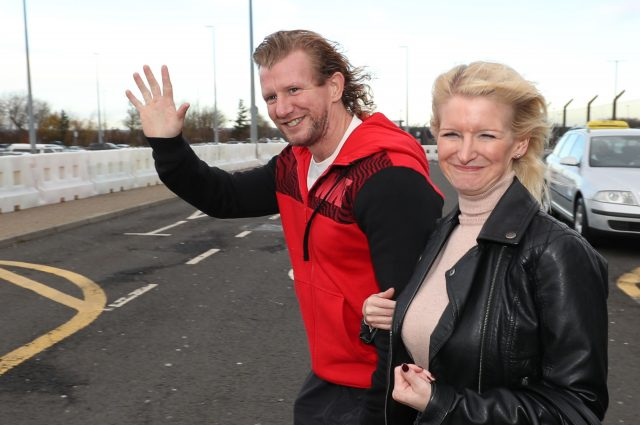 Nick Dunn and sister Lisa as he arrives at Newcastle Airport (Scott Heppell/PA)