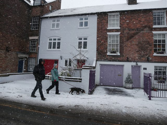Dog walkers brave the elements in Ironbridge (Nick Potts/PA)