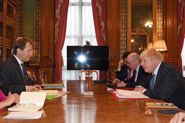 Boris Johnson meets Richard Ratcliffe. (Stefan Rousseau/PA )