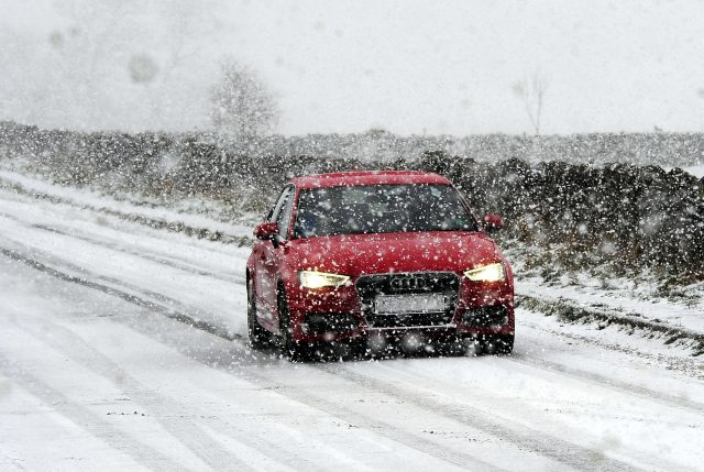 Snow falling near Castleton in the Peak District. (John Giles/PA)