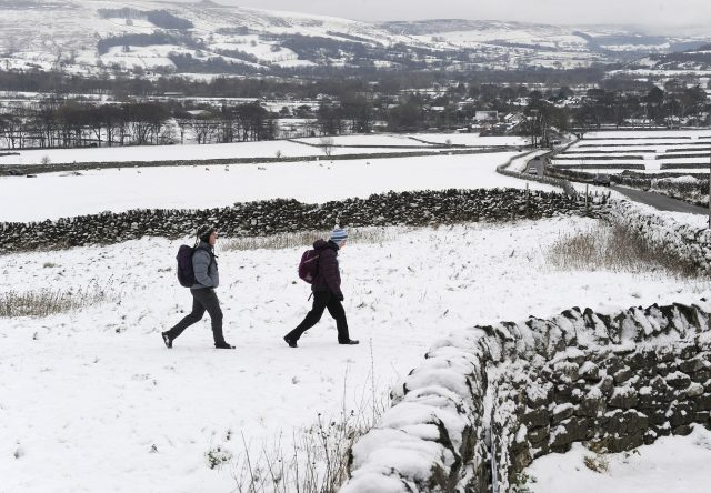 Walkers in the Peak District. (John Giles/PA)